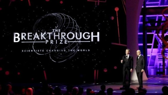 Facebook CEO Mark Zuckerberg and Russian billionaire investor Yuri Milner speak onstage during a Breakthrough Prize awards ceremony in 2016. (Getty Images for Breakthrough Prize / Kimberly White).
