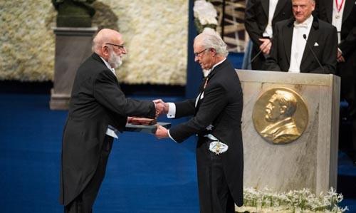 Prof. François Englert receiving his Nobel Prize from his Majesty King Carl XVI Gustaf of Sweden at the Stockholm Concert Hall, 10 December 2013. Credit: Nobel Media AD 2013.