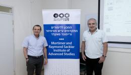 Prof. Gil Ast and Prof. Alberto Kornblihtt at his lecture